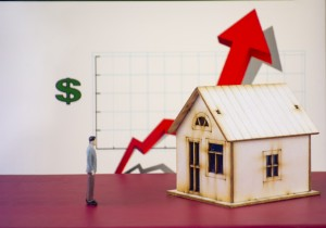 Arrows And Houses Symbolizing Rising House Prices