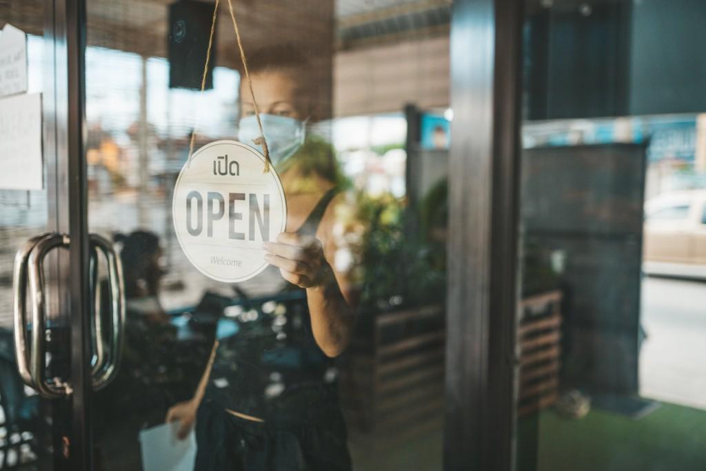 Store Owner In Medical Mask Closed Restaurant For Quarantine