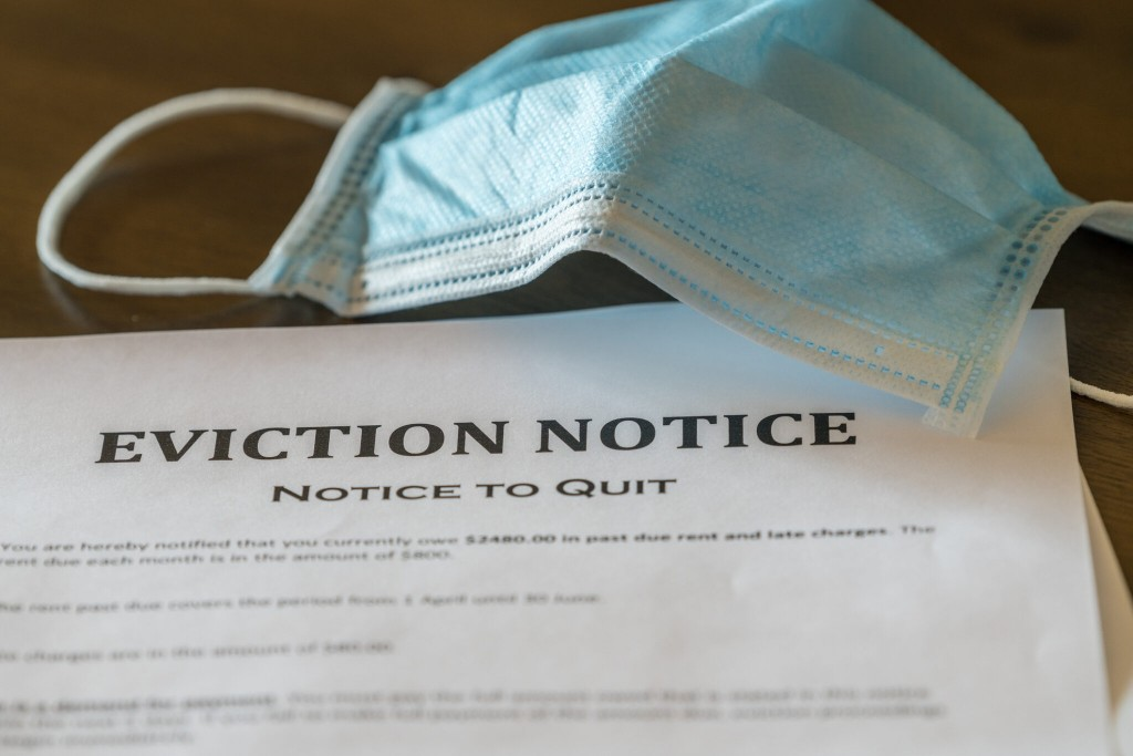 Official Legal Eviction Order Or Notice To Renter Or Tenant Of Home With Face Mask